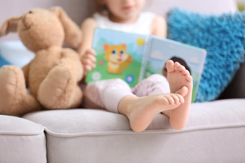 Child Reading with Bear-copyrighted image